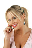 Giovane femmina bionda attraente che fa una chiamata di telefono Fotografia Stock