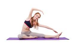 Giovane femmina che fa gli esercizi Fotografia Stock