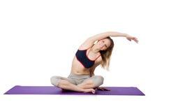 Giovane femmina che fa gli esercizi Immagine Stock