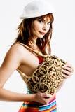 Giovane femmina con un sacchetto di mano Immagini Stock