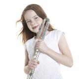 Giovane flauto dai capelli rossi delle tenute della ragazza in studio Fotografie Stock