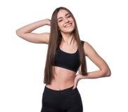 Giovane forma-ragazza sorridente nello stile di sport isolata su fondo bianco Concetto sano di stile di vita fotografie stock