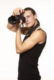 Giovane fotografo con la macchina fotografica Immagine Stock
