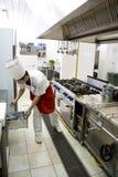 Giovane funzionamento del cuoco unico Fotografia Stock Libera da Diritti