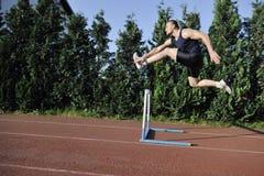 Giovane funzionamento dell'atleta Fotografie Stock