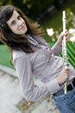 Giovane holding attraente della donna la sua scanalatura Fotografia Stock Libera da Diritti