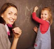 Giovane insegnante grazioso con l'allievo Fotografia Stock