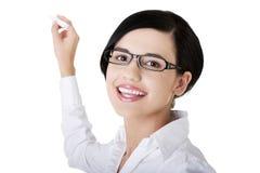 Giovane insegnante o allievo con gesso a disposizione Fotografia Stock Libera da Diritti
