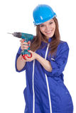 Giovane lavoratrice con il trivello Immagine Stock