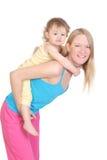 Giovane madre allegra ed il suo bambino Fotografie Stock