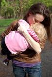 Giovane madre con la piccola figlia Fotografie Stock