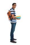 Giovane maschio indiano dell'istituto universitario con fondo bianco isolato Immagini Stock