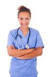 Giovane medico con lo stetoscopio isolato su fondo bianco fotografia stock