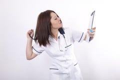 Giovane medico femminile sollecitato Fotografia Stock Libera da Diritti