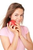 Giovane mela felice della holding della donna fotografia stock