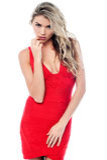 Giovane modello femminile in vestito da cocktail rosso Fotografia Stock Libera da Diritti