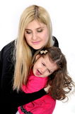 Giovane mummia e la piccola figlia. Immagini Stock