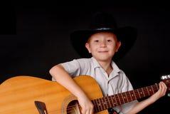 Giovane musicista del cowboy fotografia stock libera da diritti