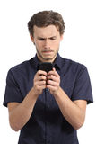 Giovane ossessionato con il suo Smart Phone Fotografia Stock Libera da Diritti