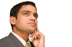 Giovane pensiero dell'uomo d'affari. Immagini Stock