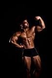 Giovane posizione del bodybuilder Immagine Stock