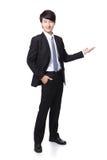 Giovane presentazione bella dell'uomo di affari Immagine Stock