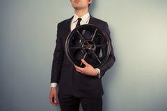 Giovane produttore con la bobina di film Immagine Stock Libera da Diritti
