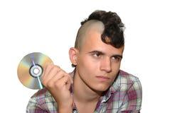Giovane punk con un disco compatto. Immagine Stock