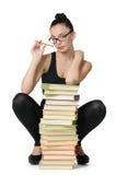 Giovane ragazza affascinante dell'allievo con i libri Fotografia Stock
