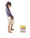 Giovane ragazza asiatica con i libri II Fotografia Stock