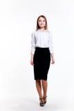 Giovane ragazza attraente di affari su un fondo bianco Fotografia Stock