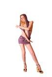 Giovane ragazza bionda sexy sveglia nell'isolato viola del pannello esterno Immagini Stock