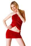 Giovane ragazza bionda sveglia in pannello esterno rosso isolato immagine stock libera da diritti