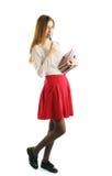 Giovane ragazza dell'allievo con i libri Fotografia Stock