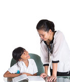 Giovane ragazza della scuola che studia con l'insegnante III Immagine Stock