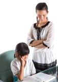Giovane ragazza della scuola che studia con l'insegnante IX Fotografie Stock Libere da Diritti