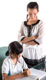 Giovane ragazza della scuola che studia con l'insegnante V Fotografia Stock Libera da Diritti