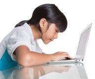 Giovane ragazza della scuola con il computer portatile VII Immagine Stock