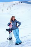 Giovane ragazza dello snowboarder Fotografie Stock Libere da Diritti