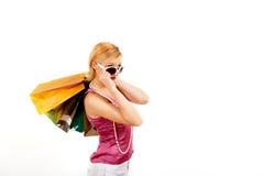 Giovane ragazza di acquisto sexy con i sacchetti del colourfull Fotografie Stock Libere da Diritti