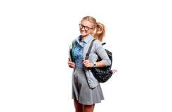Giovane ragazza felice dell'allievo Di nuovo al banco Immagini Stock Libere da Diritti