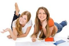 Giovane ragazza felice dell'allievo due, isolata su bianco Immagine Stock Libera da Diritti