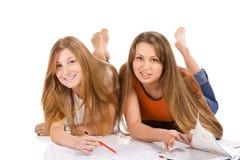 Giovane ragazza felice dell'allievo due, isolata su bianco Fotografia Stock