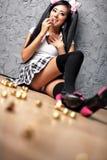 Giovane ragazza giapponese con i lotti dei dolci Immagini Stock Libere da Diritti