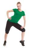 Giovane ragazza sportiva che fa allungando esercizio isolato Fotografie Stock
