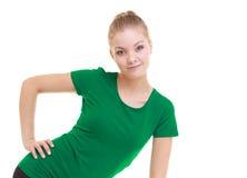 Giovane ragazza sportiva che fa allungando esercizio isolato Immagini Stock
