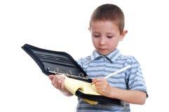 Giovane ragazzo che cattura le note Fotografie Stock Libere da Diritti