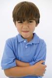 Giovane ragazzo che fa fronte Fotografia Stock Libera da Diritti