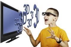 Giovane ragazzo che guarda televisione 3D Fotografia Stock Libera da Diritti