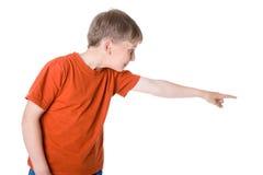 Giovane ragazzo che indica a Fotografia Stock